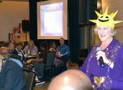 Professional Speaker, Sheryl Roush, engages with the audience